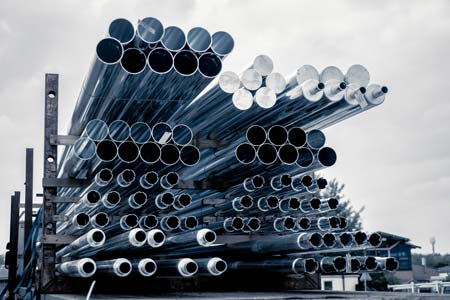 piles of steel pipes in-store